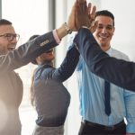 team-high-fiving-successful-rebate-strategy