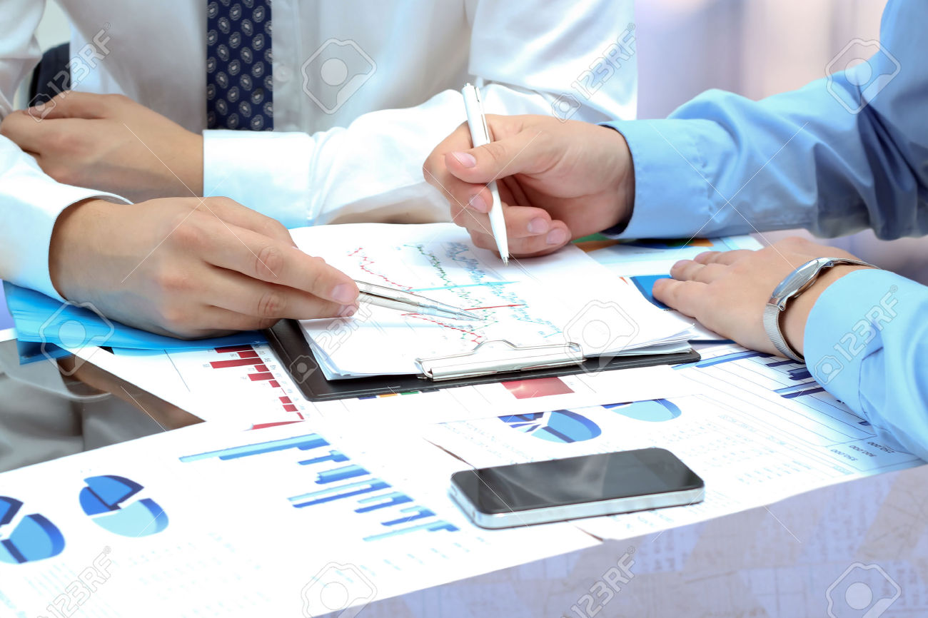 36398803-business-colleagues-working-together-and-analyzing-financial-figures-on-a-graphs-stock-photo.jpg